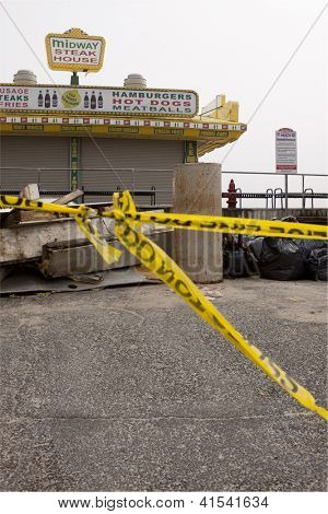 SEASIDE HEIGHTS, NJ - JAN 13: Police tape seals off the Midway Steak House on January 13, 2013 in Seaside Heights, NJ. Cleanup continues 75 days after Hurricane Sandy struck the shore in October 2012.