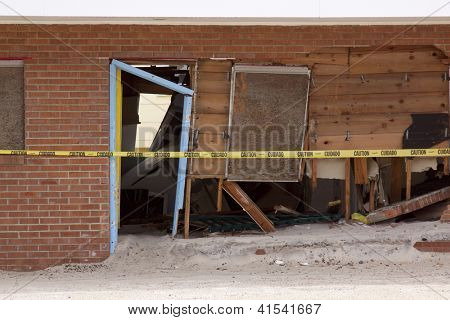 SEASIDE HEIGHTS, NJ - JAN 13: Cracked bricks and broken wooden boards of a building destroyed when Hurricane Sandy struck the shore in October 2012 on January 13, 2013 in Seaside Heights, New Jersey.