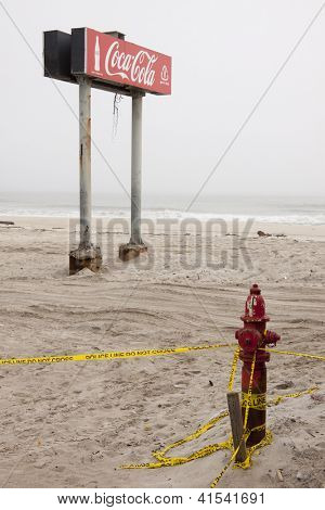SEASIDE HEIGHTS, NJ - JAN 13:The boardwalk Coca Cola sign in the fog on January 13, 2013 in Seaside Heights, New Jersey. Clean up continues 75 days after Hurricane Sandy hit the shore in October 2012.