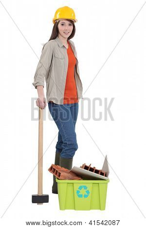 Female construction worker recycling old material