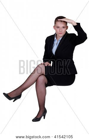 Businesswoman peering into the distance