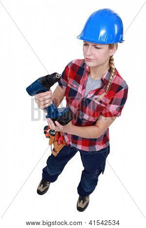 Woman with a cordless power drill