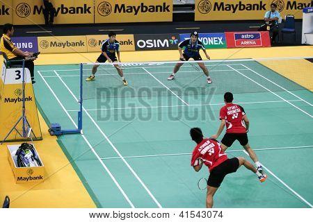 KUALA LUMPUR - JANUARY 15: Malaysia's Chan/Ong (blue) play against Indonesia's Wirawan/Septano at the Maybank Malaysia Open 2013 Badminton event on January 15, 2013 in Kuala Lumpur, Malaysia.