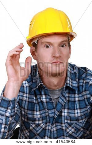 Dumbfounded construction worker