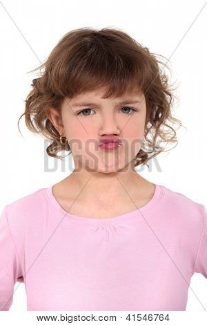 little girl pouting