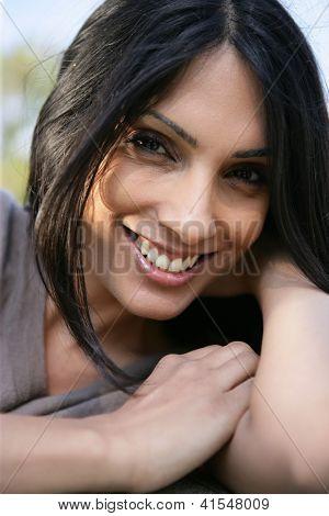 Portrait of attractive brunette outdoors