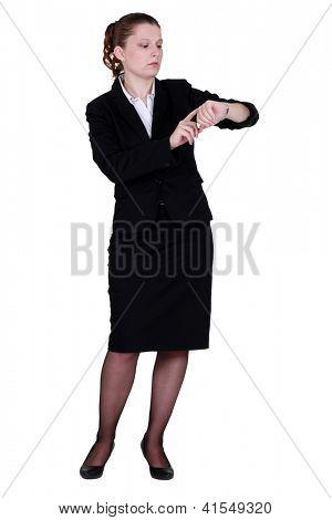 Businesswoman looking at wrist watch
