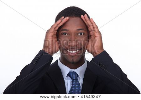 Businessman playing peek-a-boo