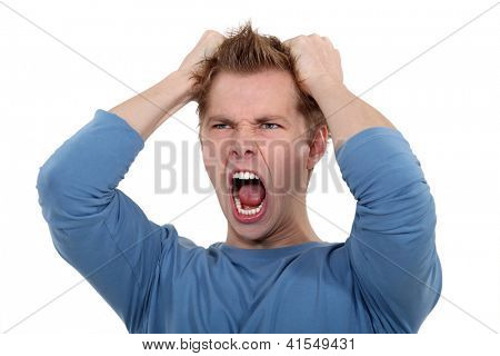 Man screaming and pulling his hair