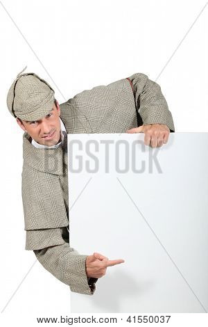 man in Sherlock Holmes costume showing message