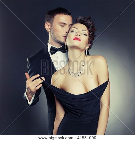 Fashion photo of sexy elegant couple in the tender passion