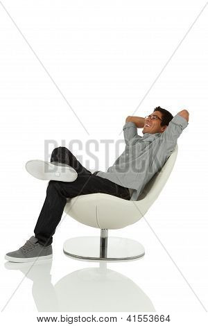 Young adult relaxing on a chair