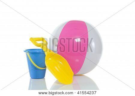 Beach ball, bucket and shovel