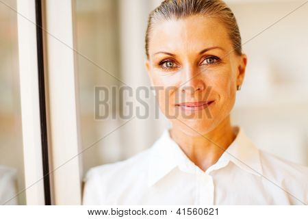elegant middle aged businesswoman closeup portrait in office