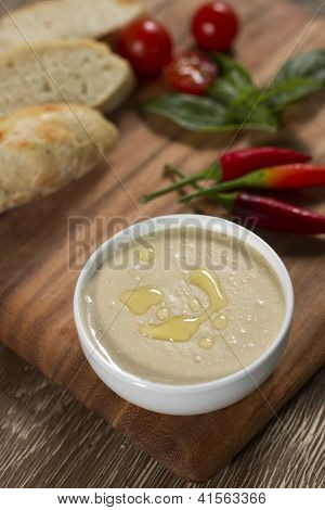 Humus in white bowl