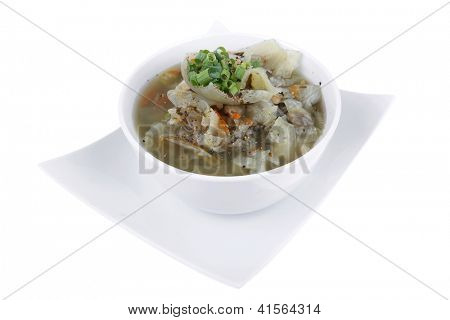 hot fresh diet vegetable soup isolated over white background