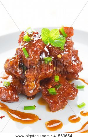Chinese spare ribs cuisine dish, close up delicious Asian food ready to serve in plate.