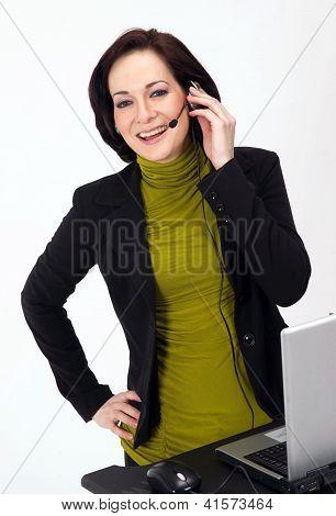 Female Customer Service Worker Smiles Talking On Headset Phone
