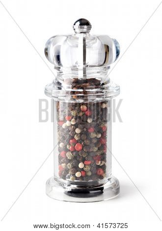Colored Peppers Mix and pepper grinder on white background
