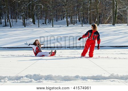 Mother And Daughter In Snowy Winter Park