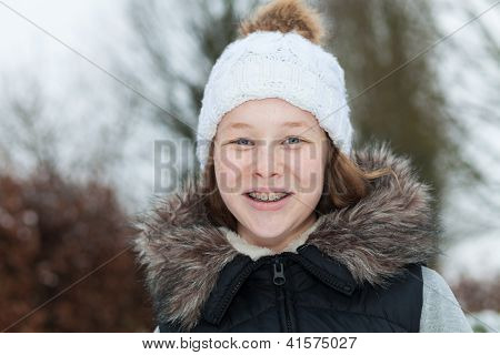 Smiling Teenager Girl In A Winter Park