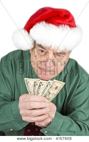 Man With Santa Hat Holding A Bunch Us Dollars