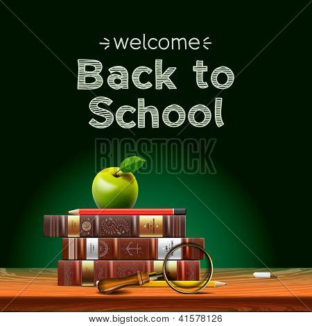 Back to school, school books with apple on desk.