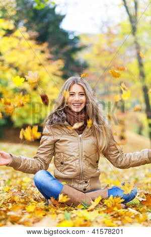Cheerful Woman In Autumn