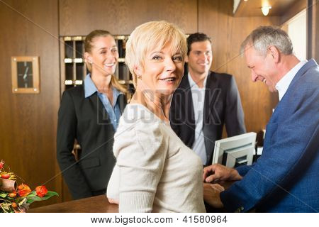 Reception - Guests check in at hotel and getting information