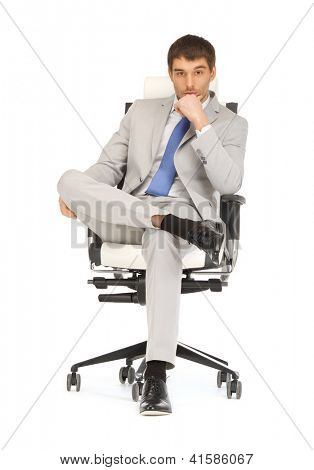 bright picture of handsome man sitting in chair