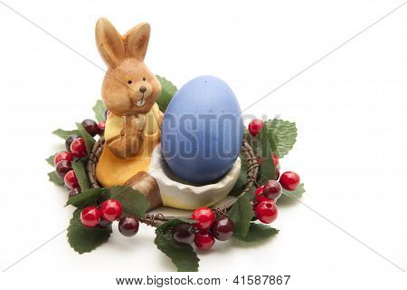 Easter bunny with Blue Easteregg and Flower