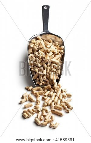Wooden pellets -bio fuel on scoop.