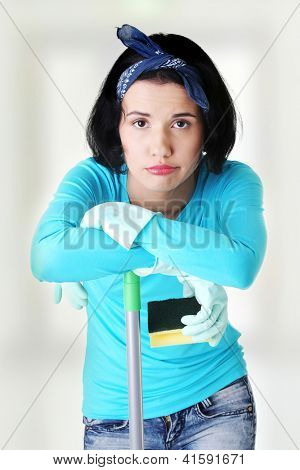 Tired and exhausted cleaning woman portrait