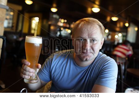 Man Posing With Glass Of Beer