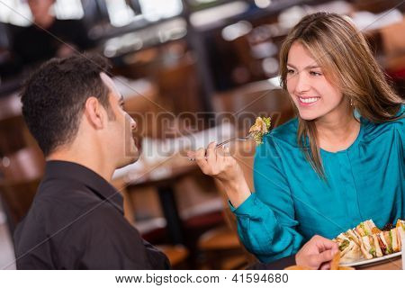 Woman having dinner with her boyfriend at a restaurant