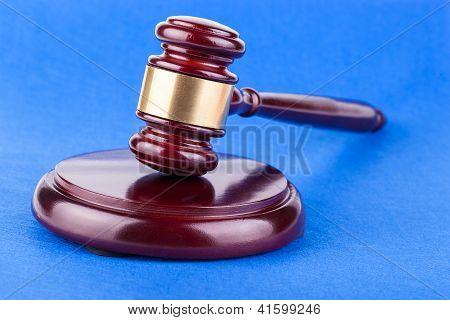 Judges Gavel On Blue Background