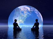 stock photo of earth  - Two human silouhettes meditating in front of the earth by night - JPG