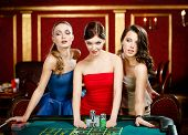 foto of roulette table  - Three women bet playing roulette at the gambling house - JPG