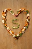picture of satsuma  - Fresh sliced fruit in a heart shape with plums - JPG