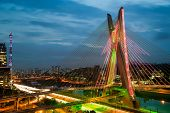 stock photo of bridge  - Most famous bridge in the city at dusk Octavio Frias De Oliveira Bridge Pinheiros River Sao Paulo Brazil - JPG
