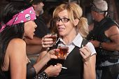 stock photo of peer-pressure  - Blond woman and biker gang lady talking while smoking and drinking - JPG