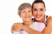 stock photo of granddaughter  - happy senior mother and adult daughter closeup portrait on white - JPG