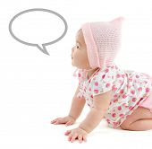 Six months old East Asian baby girl with announcement talk bubble crawling on white background