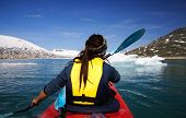 Kayak With Icebergs