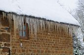 Icicles Hanging From House Roof