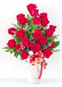 stock photo of purple iris  - Bouquet of red roses in a vase - JPG