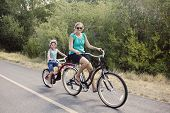 foto of tandem bicycle  - Family Enjoying a Bike Ride - JPG