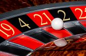 stock photo of roulette table  - Classic casino roulette wheel with red sector twenty - JPG