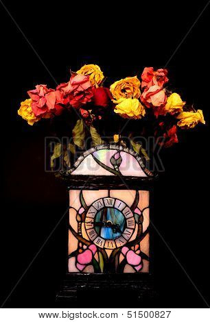 Clock And Dead Flowers