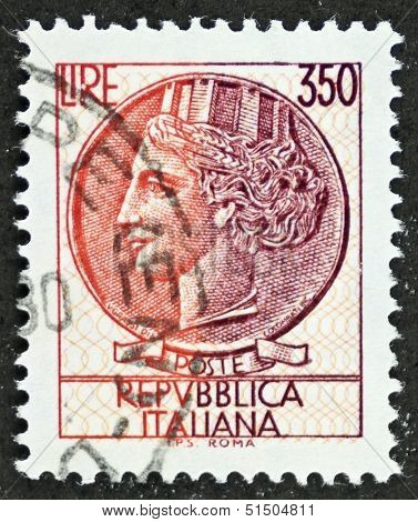 ITALY - CIRCA 1977: a stamp printed in Italy shows  head of Italia Turrita (Italy with towers), national personification and allegory of Italy. Italy, circa 1977